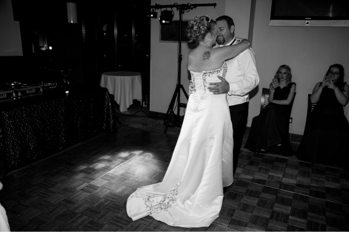 black and white bride and groom dancing