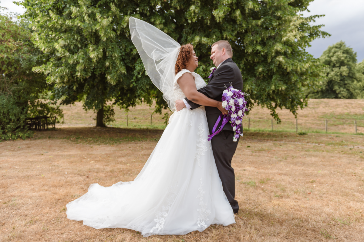 bride and groom in grounds veil floating